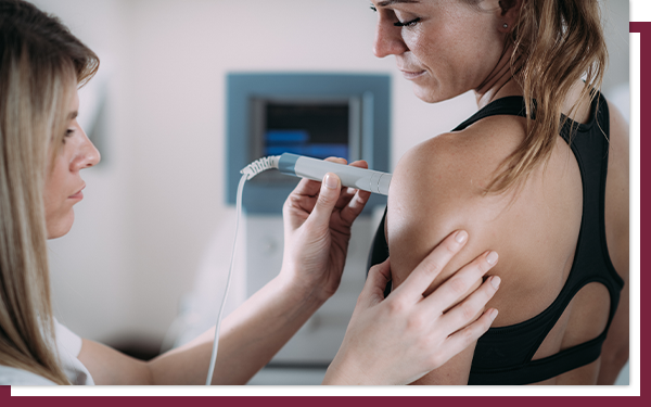 A young woman receives an ultrasound on her breast.